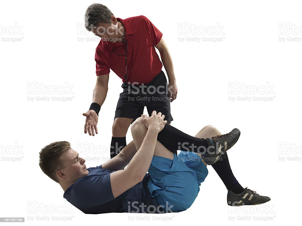 Soccer player's injury isolated royalty-free stock photo
