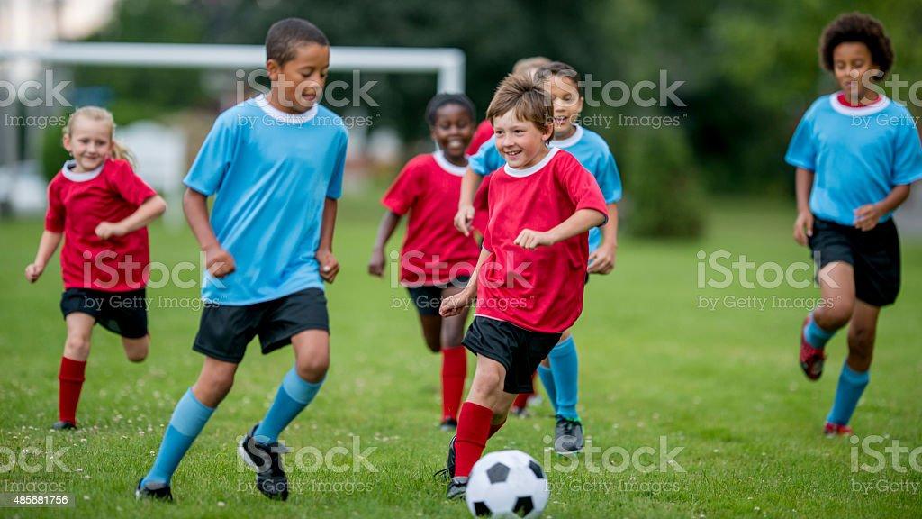 Soccer Players Kicking the Ball stock photo