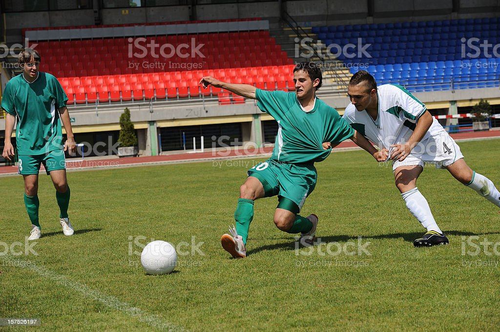 Soccer players performing dirty game stock photo