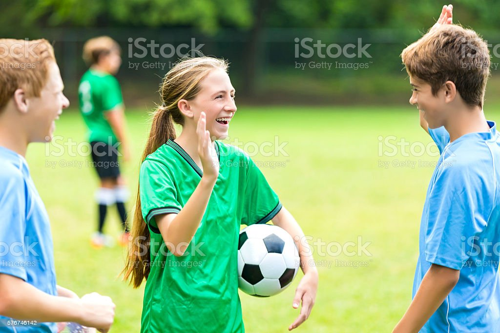 Soccer players prepare to high five after game stock photo