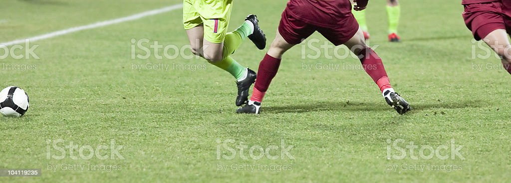 Soccer players running after the ball royalty-free stock photo