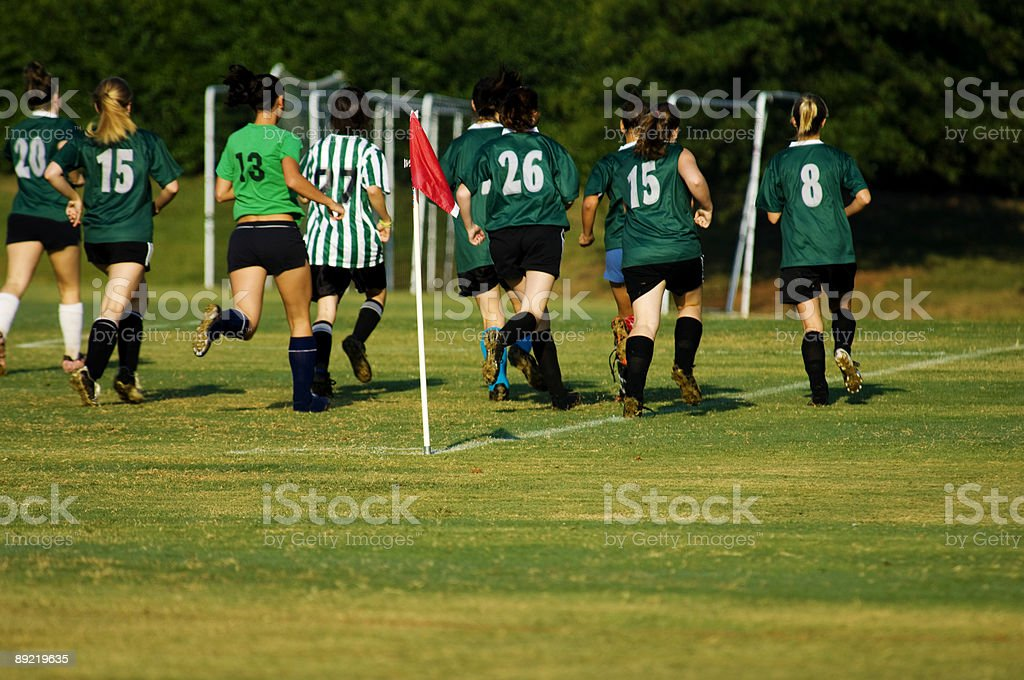 Soccer Players Running on Soccer Field during Soccer Game stock photo