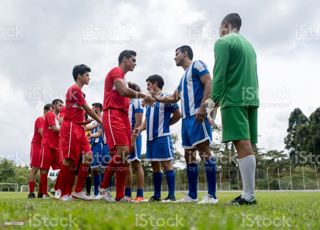 Soccer players shaking hands before the match stock photo