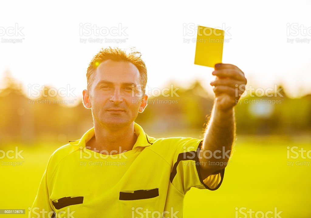 Soccer referee at sunset. stock photo