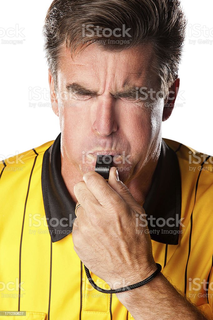 Soccer Referee Blowing Whistle royalty-free stock photo
