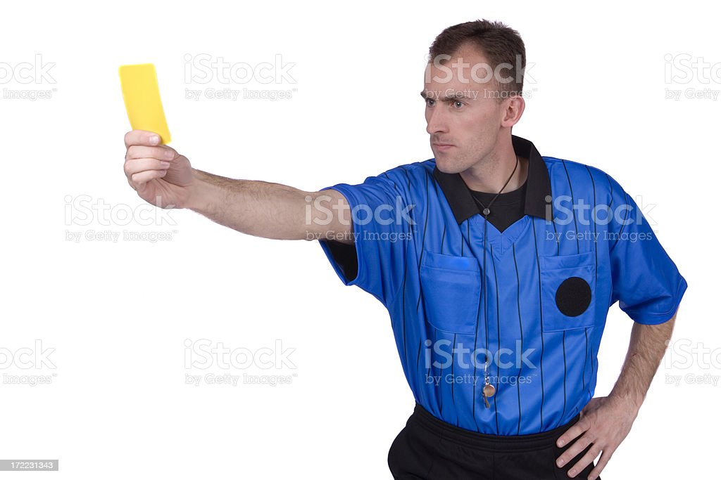 Soccer referee displaying yellow card stock photo