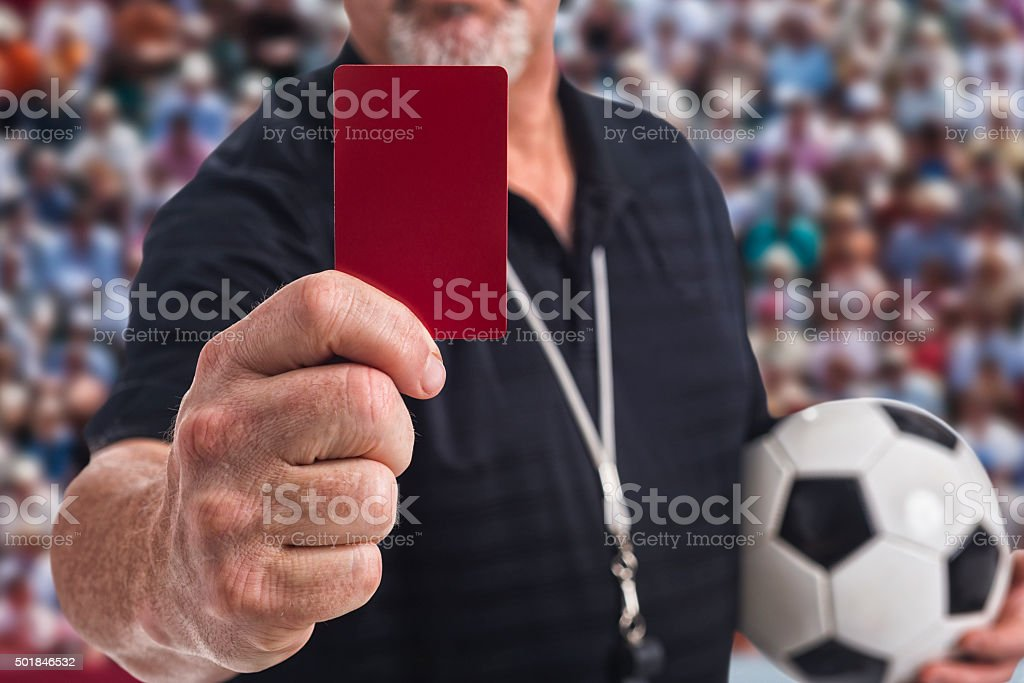 Soccer Referee holding a Red Card at camera stock photo