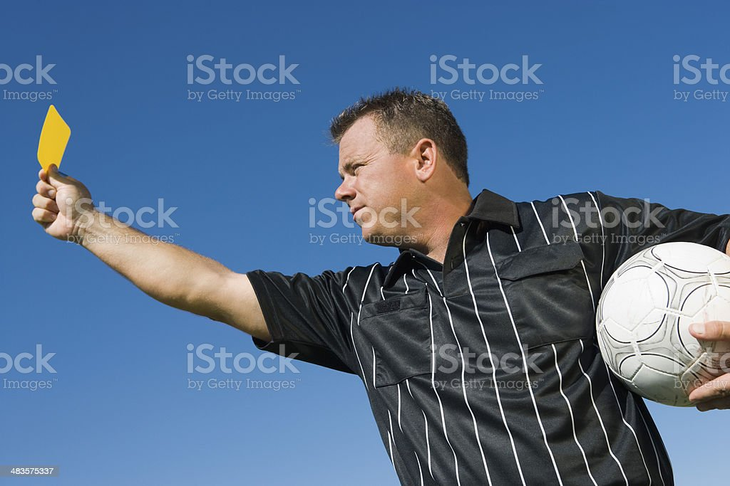 Soccer Referee Holding Yellow Card stock photo