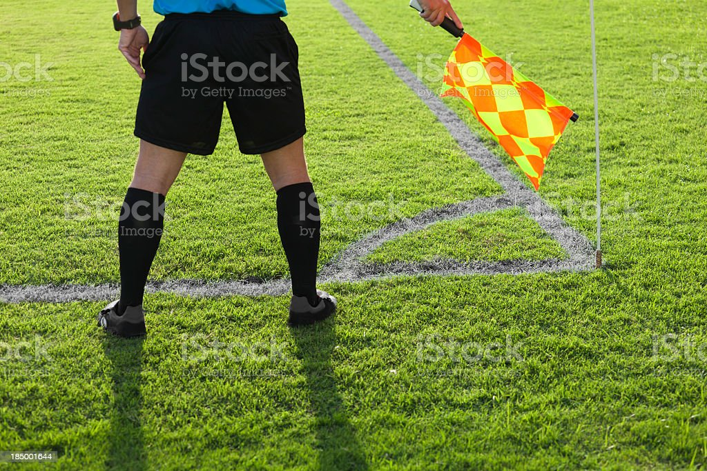 A soccer referee playing close attention on the aisle stock photo