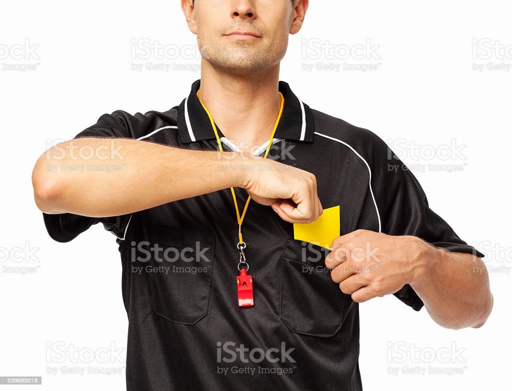 Soccer Referee Removing Yellow Card From Pocket stock photo
