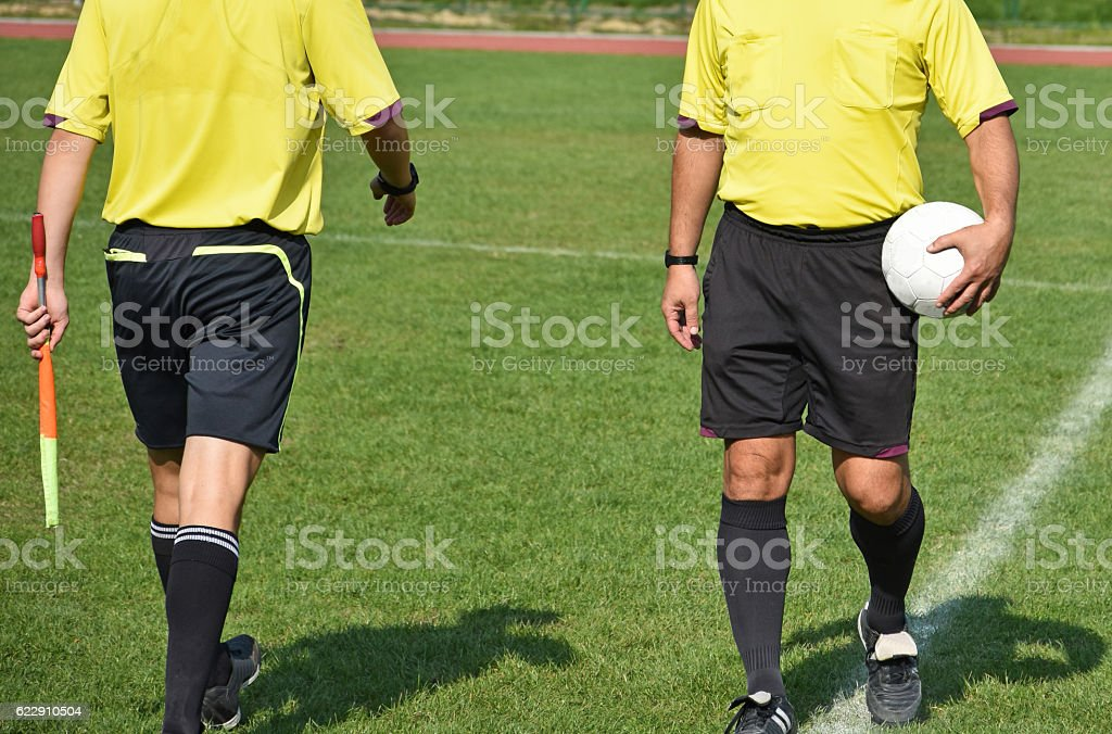 Soccer referees before match stock photo