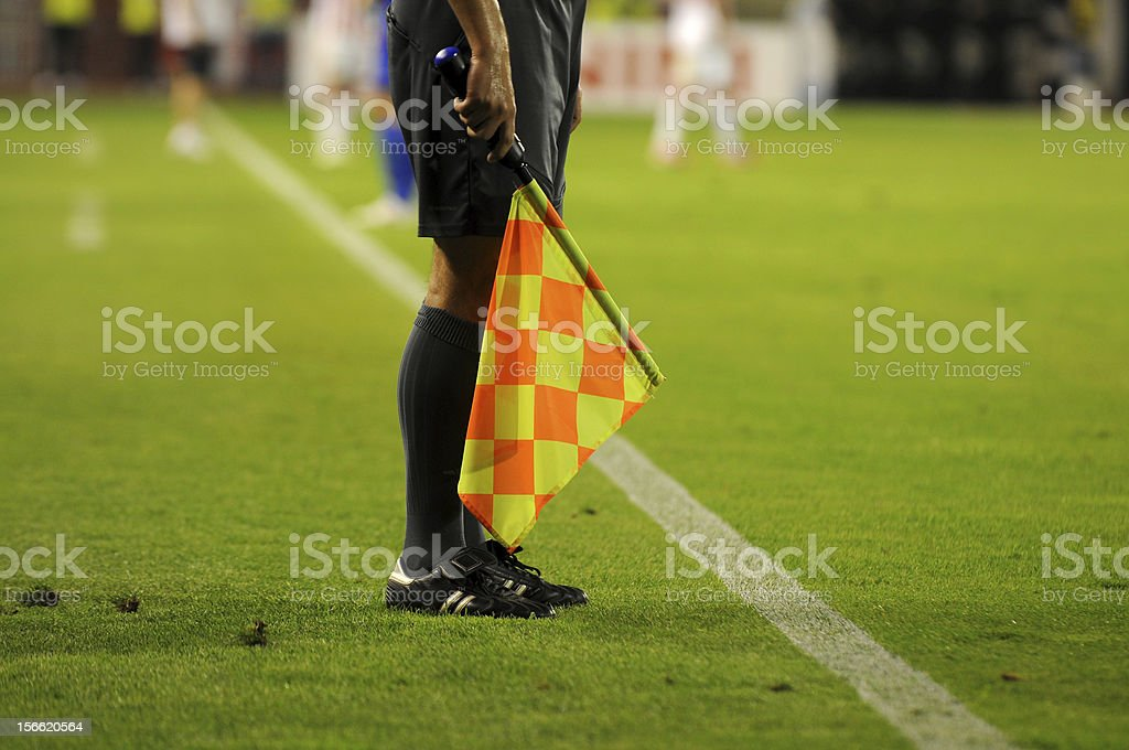 Soccer referee's checkered flag on a soccer field stock photo