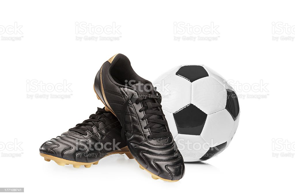 Soccer shoes and a football stock photo