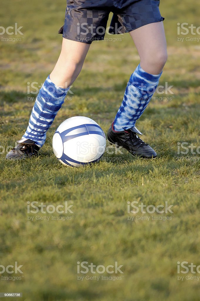 Soccer shoes and ball royalty-free stock photo