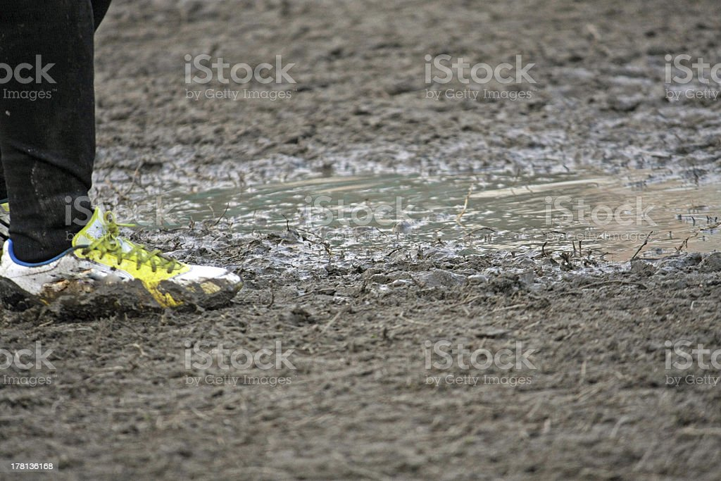 soccer shoes of a child player during  football match stock photo