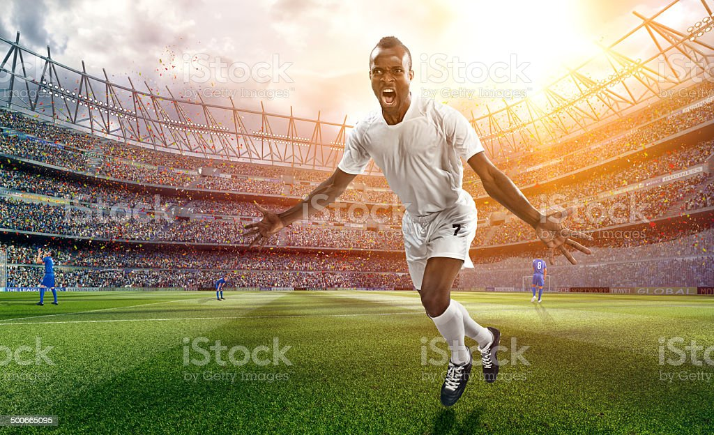 Soccer stadium and soccer player is happy after goal royalty-free stock photo