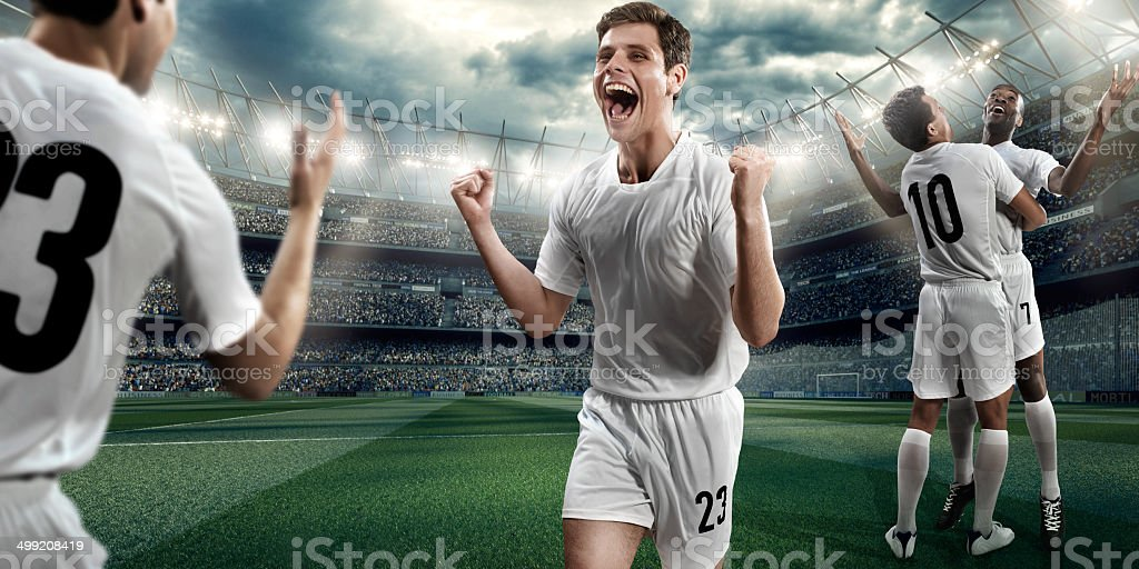 Soccer stadium and soccer players happy after victory royalty-free stock photo