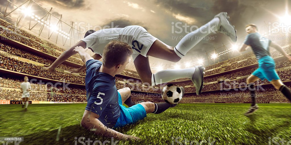 Soccer stadium and soccer players in action stock photo