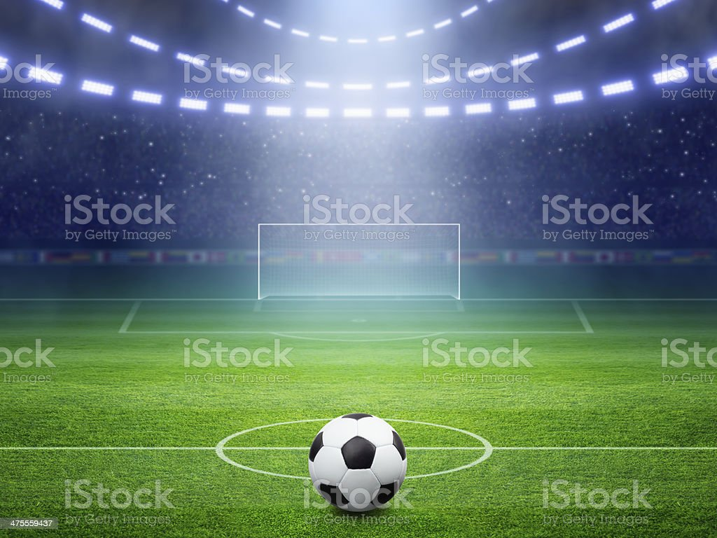 Soccer stadium with illuminated field and arena stock photo