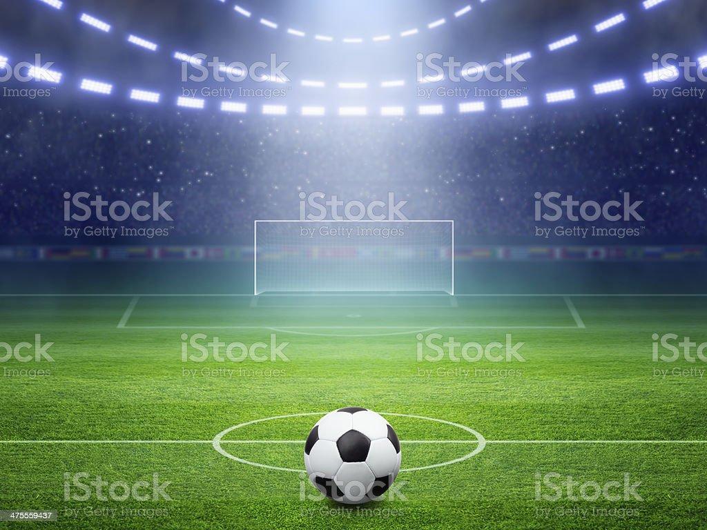 Soccer stadium with illuminated field and arena stock photo