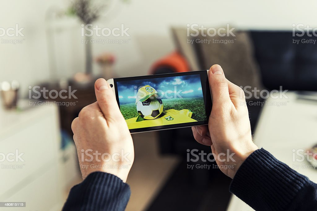 Soccer streaming from Brazil on mobile phone stock photo
