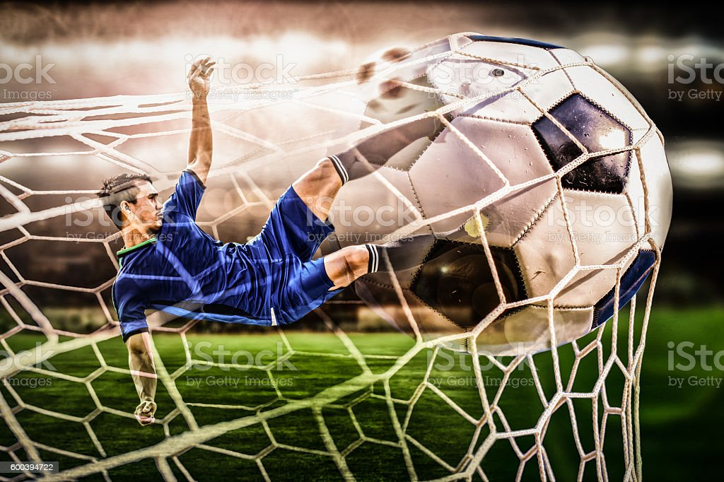 soccer striker shooting ball in the stadium stock photo