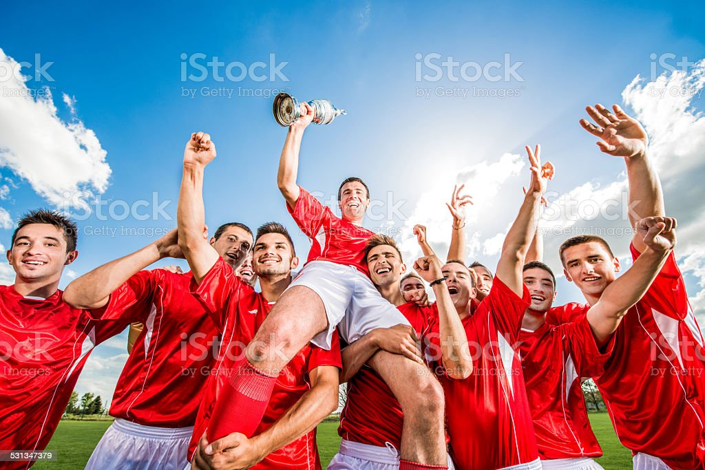 Soccer team celebrating. stock photo