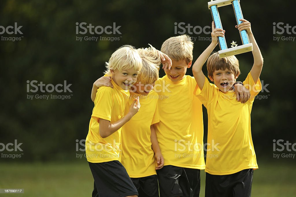 Soccer Team Celebrating With Trophy royalty-free stock photo