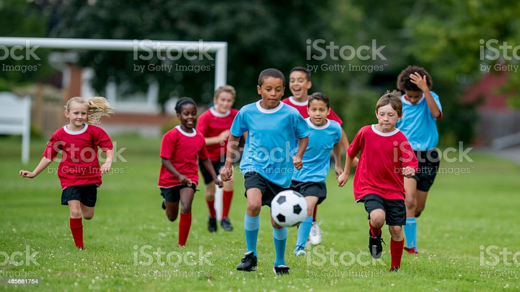 Soccer Team Chasing the Ball stock photo