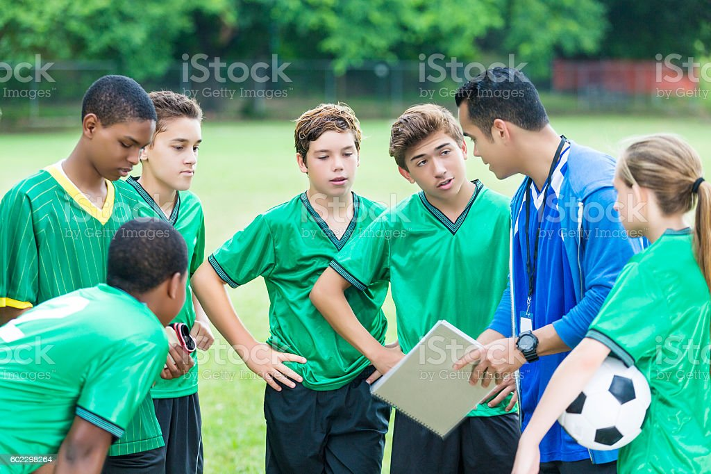 Soccer team during time out with coach stock photo