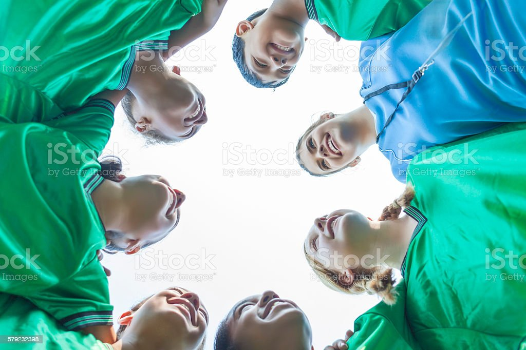 Soccer team huddles in a circle stock photo