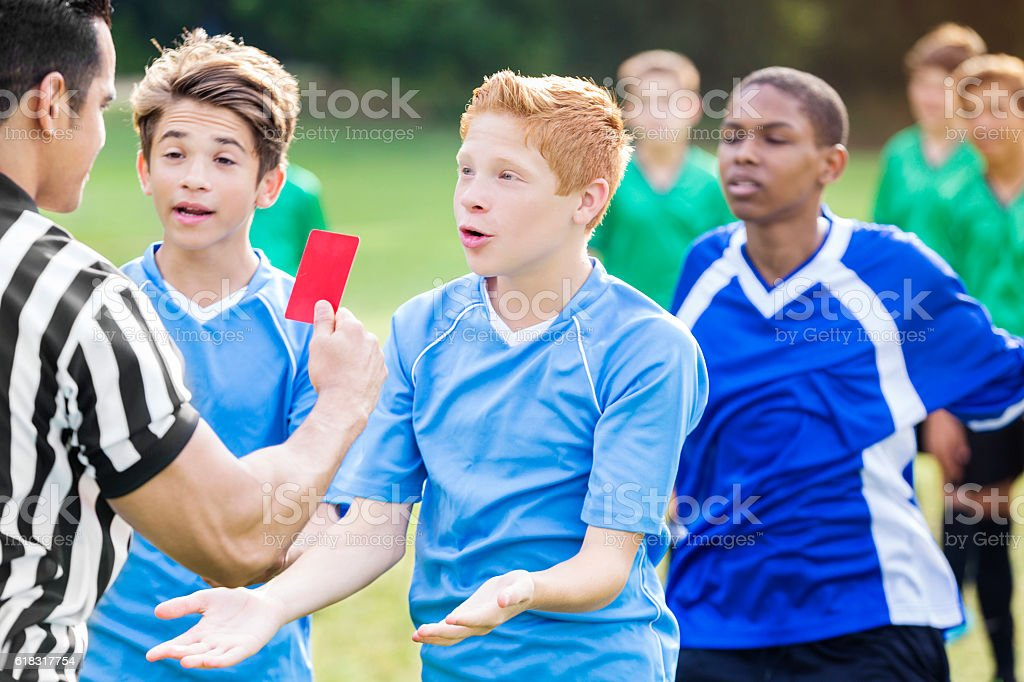 Soccer team ojects to referee's penalty call stock photo