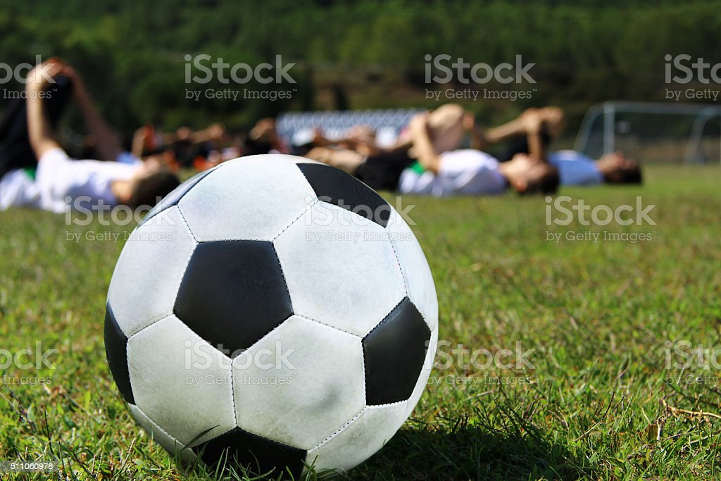 Soccer team warming stock photo