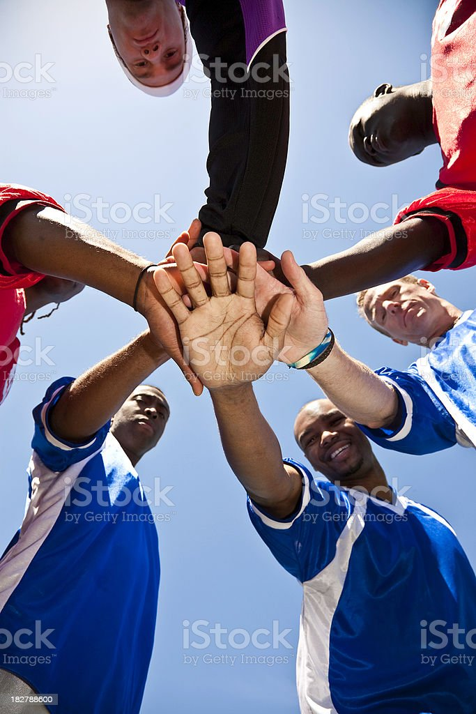 Soccer Team With Hands Together in Huddle royalty-free stock photo