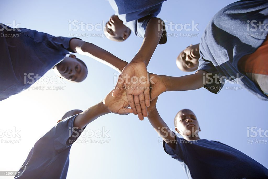 Soccer Teammates Hands Together, Gugulethu, Cape Town, South Africa. royalty-free stock photo
