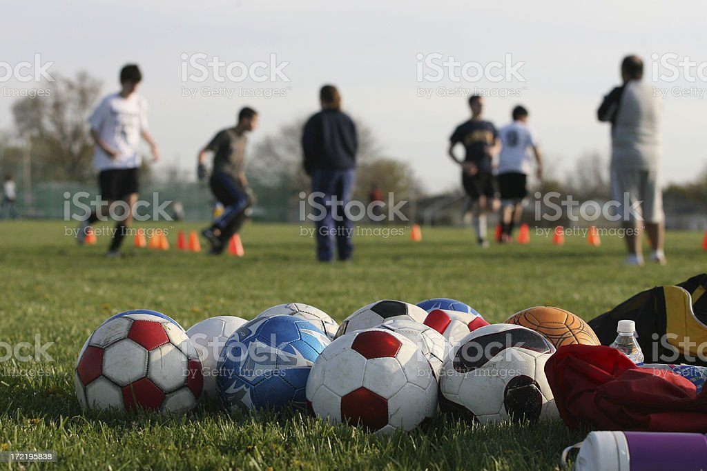 Soccer Training Drill with Balls in Foreground Hor stock photo