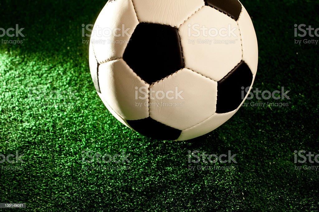Soccerball Football on green turf grass royalty-free stock photo