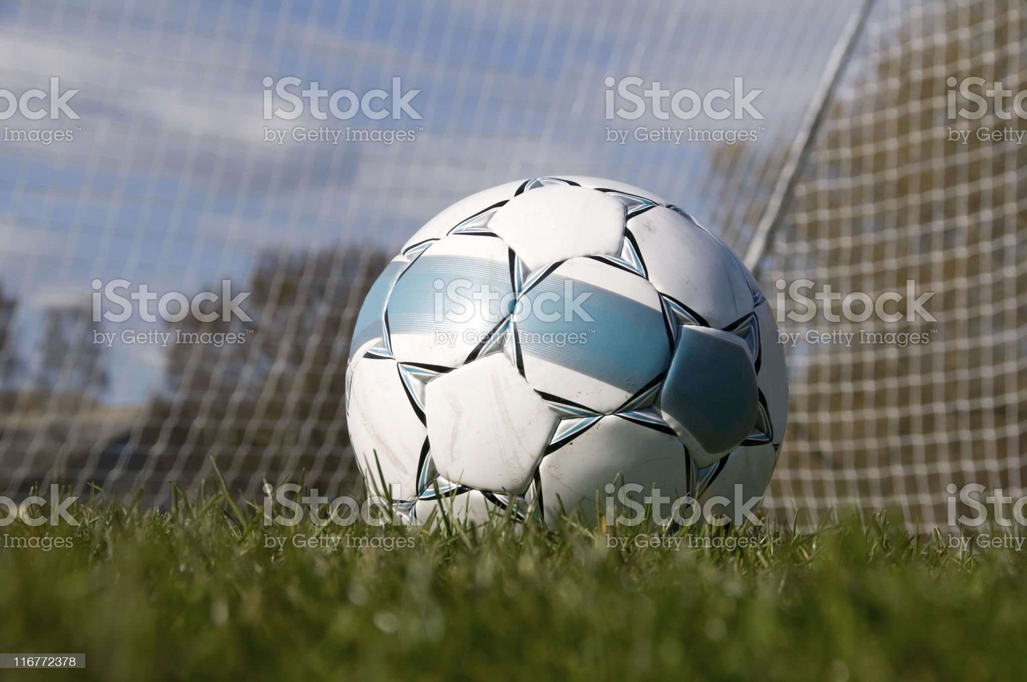 Soccerball in fron of an empty goal royalty-free stock photo