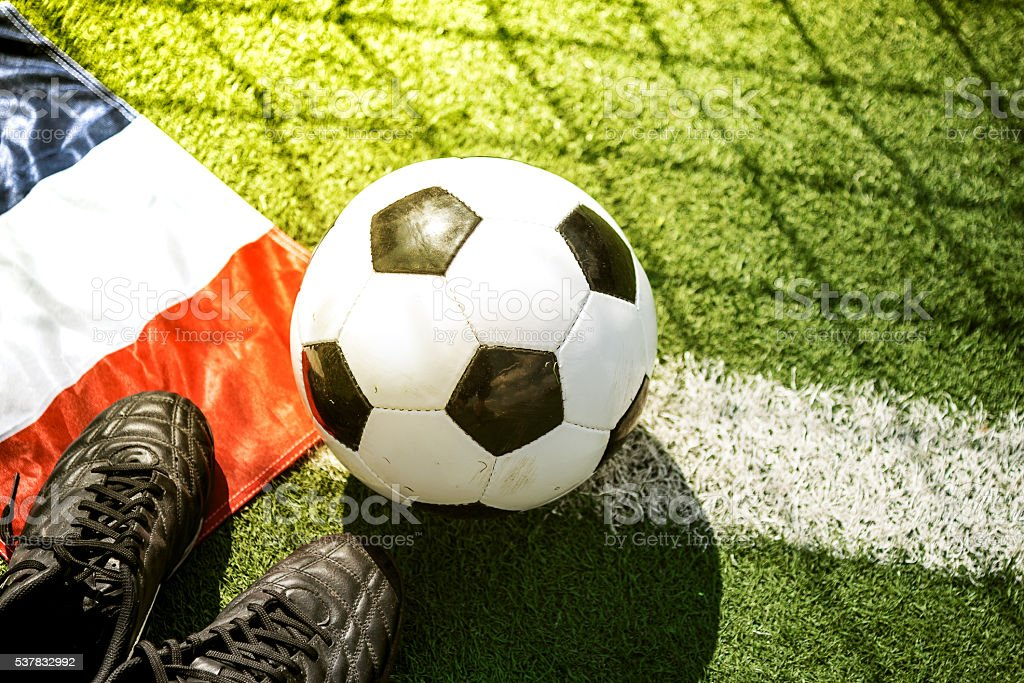 soccerball on goal line with french flag and soccer shoes stock photo