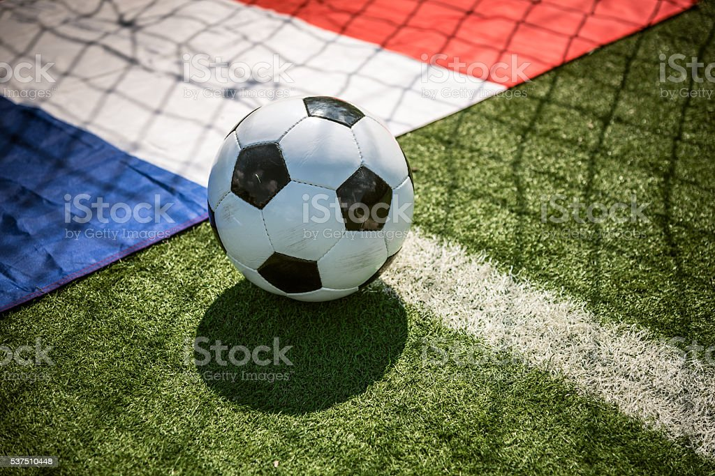 soccerball on goal line with french flag stock photo