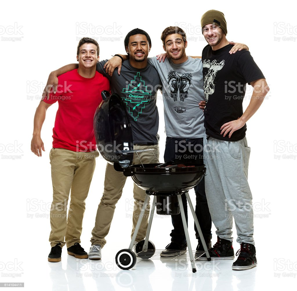 Social group of young men having a BBQ stock photo