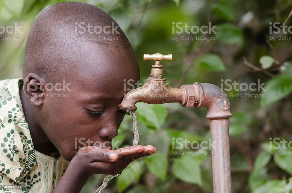 Social Issues: African Boy in need for Clean Water stock photo