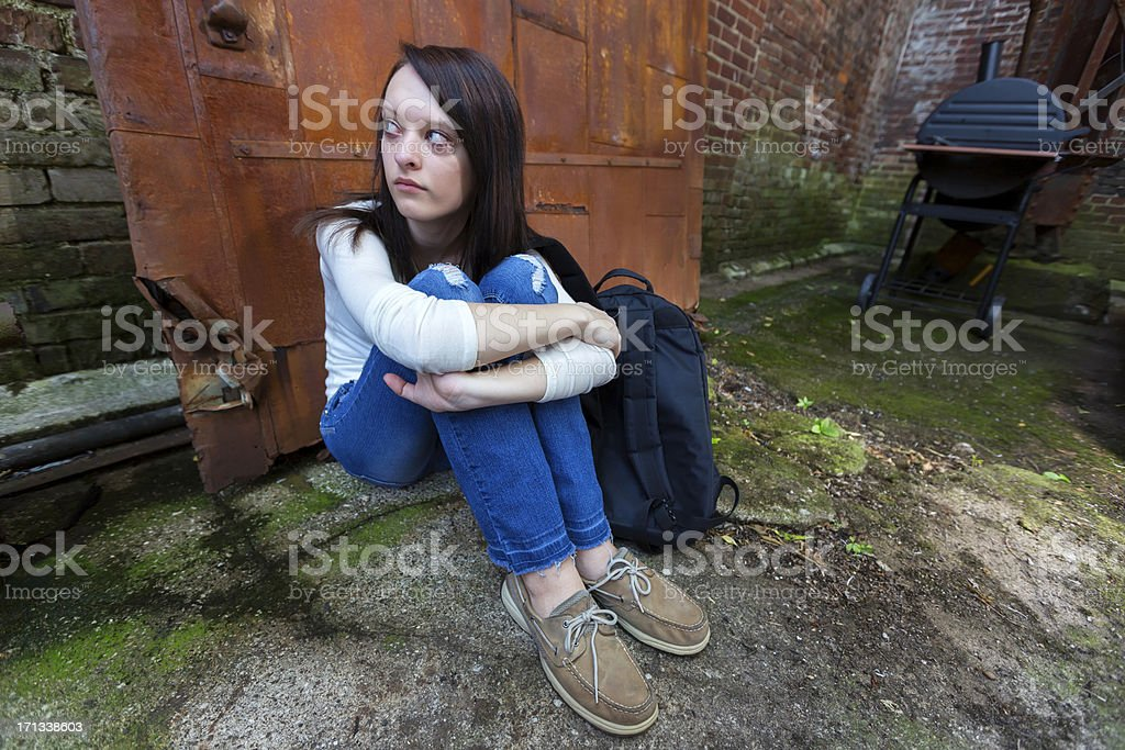 Social Issues: Homeless runaway girl in an alley royalty-free stock photo