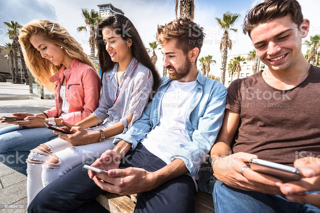 social media addiction people using the smartphone in barcelona stock photo