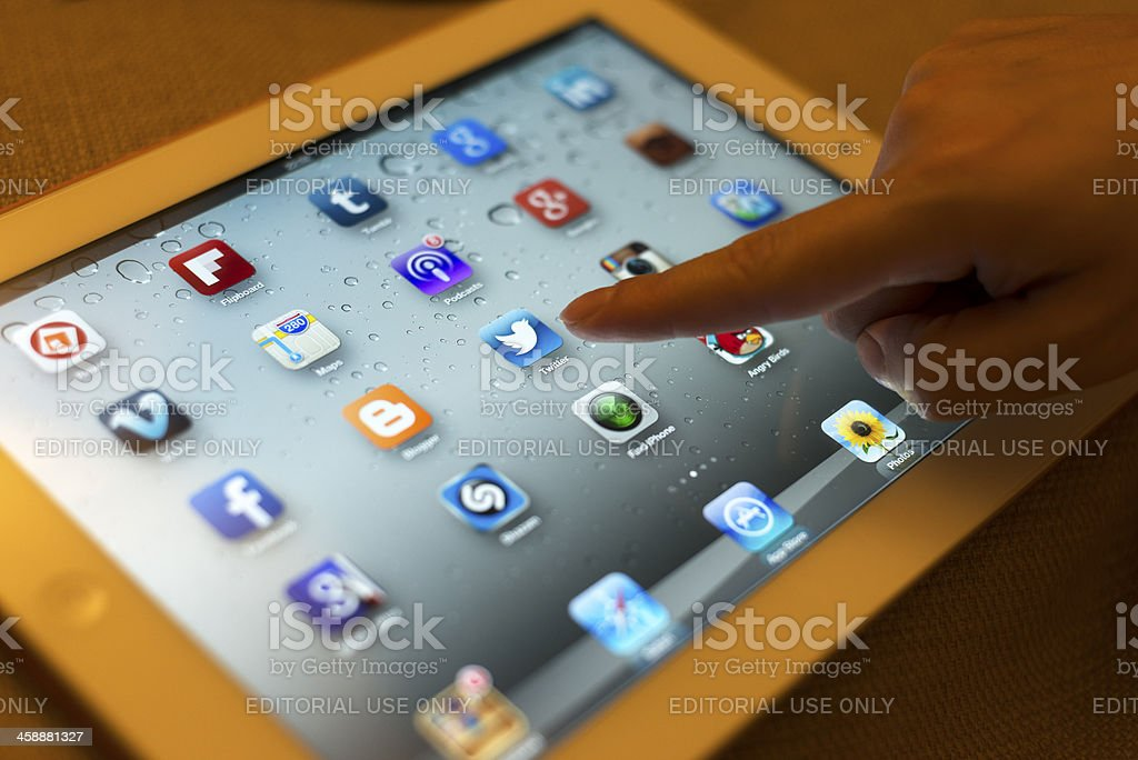 Social Media Apps Icons on Display of ipad. stock photo