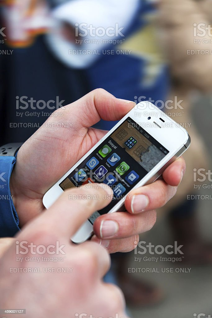 Social media apps on an Apple iPhone 4s white stock photo