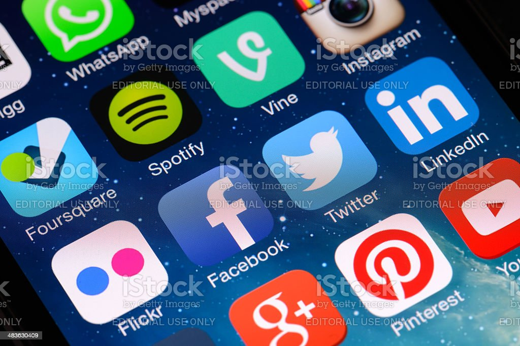 Social media apps on iPhone screen stock photo