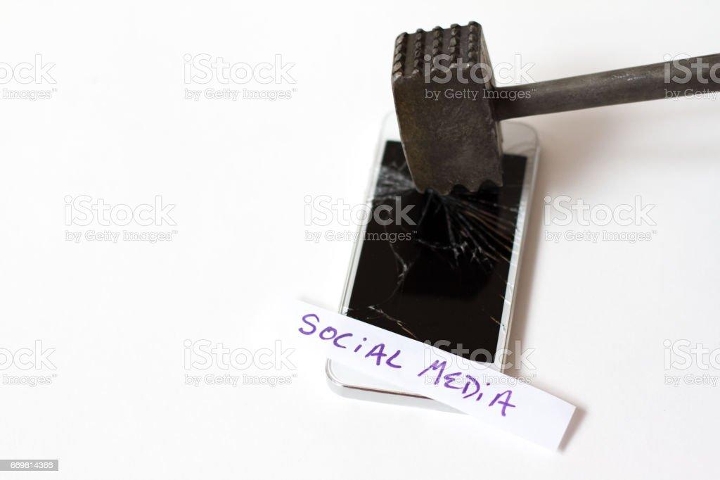 Social Media Burnout: Hammer Shattering Smart Phone Screen stock photo