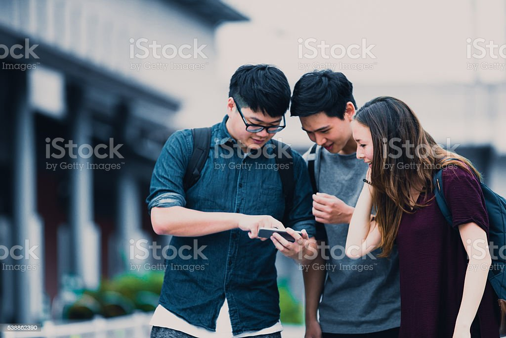 Social Media could be fun, Group of Students in Japan stock photo