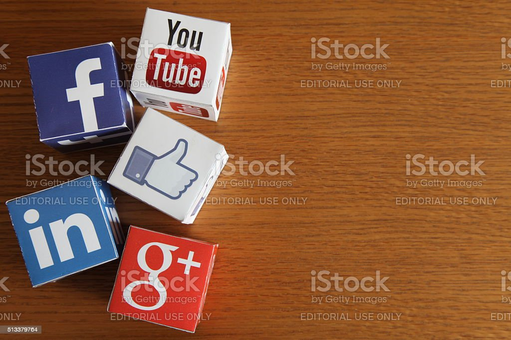 Social media icons cubes on wooden desk background stock photo